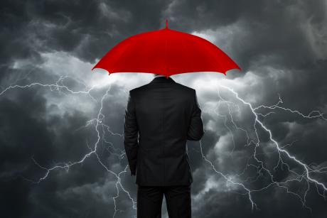 guy in storm with umbrella_shutterstock_132934481